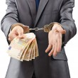 Stock Photo: Handcuffed mwith euro banknotes