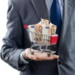Royalty-Free Stock Photo: Shopping cart full of money