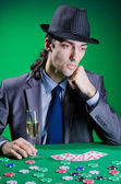 Player in casino and chips — Stock Photo