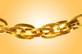 Golden jewellery against gradient background — Stockfoto