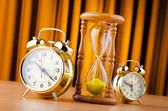 Time concept with alarm clock and hourglass — Stock Photo