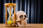 Concept of death with hourglass and skull — Stockfoto