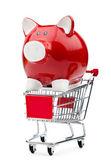 Sparschwein und shopping cart auf weiß — Stockfoto