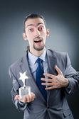 Businessman awarded with star award — Stock Photo
