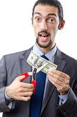 Man cutting money on white — Stock Photo