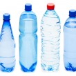 Many water bottles isolated on white - Stock fotografie