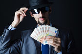 Man with counterfeit money — Stock Photo