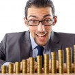 Growth concept with coins and businessman — Stock Photo