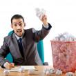 Stock Photo: Man with lots of wasted paper