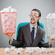 Man with lots of wasted paper — Stockfoto