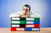 Businessman with many office folders — Foto de Stock