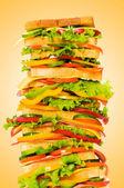 Giant sandwich against gradient background — Stock Photo