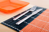 Emtpy plates with utensils on table — ストック写真