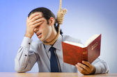 Businessman reading bible before hanging himself — Foto de Stock