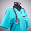 Doctor coat with the stethoscope — Stock Photo