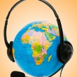 Headset on globe isolated on the white — Stock Photo #9181051