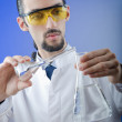 Stock Photo: Young chemist student working in lab