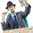 Detective detecting fake dollar banknotes - Stock Photo