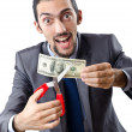 Man cutting money on white — Stock Photo #9181605