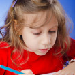 Little girl drawing with pencils — Stock Photo