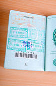 Passport with many stamped visas — Stock Photo