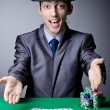 Casino player playing with chips — Stock Photo #9287867