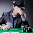Casino player playing with chips — Stock Photo #9287871