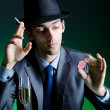 Player in casino and chips — Stock Photo #9287932