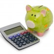 Calculator and piggy bank on white — Stock Photo