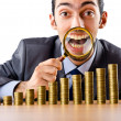 Businessman with golden coins — Stock Photo #9289019