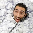 Man with lots of crumpled paper — Stockfoto #9289107