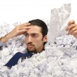 Man with lots of crumpled paper — Stock Photo #9289205