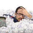 Stock Photo: Man with lots of waste paper