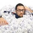 Man with lots of waste paper — Stockfoto #9289210