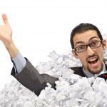 hombre con una gran cantidad de residuos de papel — Foto de Stock   #9289247