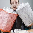 Man with lots of wasted paper — ストック写真