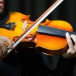 Fiddler playing the violin — Stock Photo