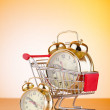 Buying time concept with clock and shopping cart — ストック写真