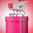 Stock Photo: Cart and giftbox in christmas shopping concept