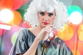Fashion concept with woman against bokeh — 图库照片