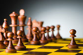 Chess concept with various pieces — Stockfoto