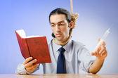 Man reading bible and taking drugs — Foto de Stock