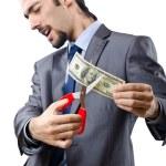 Man cutting money on white — Stock Photo #9290610