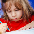 Little girl drawing with pencils — Stock Photo #9290686