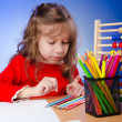 Stok fotoğraf: Little girl drawing with pencils