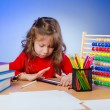 Little girl drawing with pencils - Foto Stock