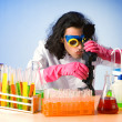 Chemist in the lab experimenting with solutions - Foto Stock