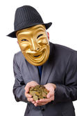 Masked man with coins on white — Stock Photo