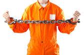 Criminal in orange robe in prison — Stock Photo