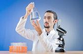 Chemist working with microscope — Stock Photo
